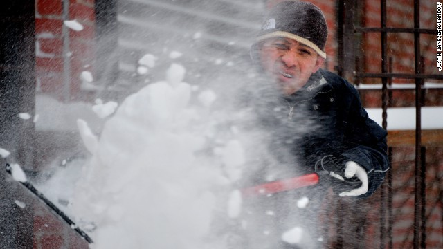 A man shovels snow during the tail end of a snowstorm in Brooklyn on January 3.