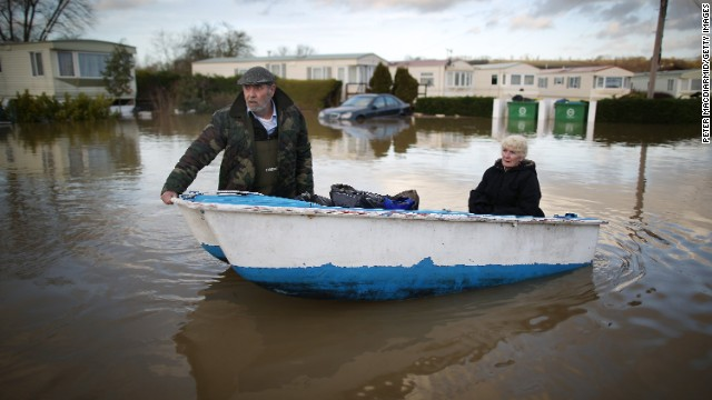 Ian Peacock and Caroline Hine rescue possessions from flooded trailers at the Little Venice Country Park in Yalding, England, on January 2.