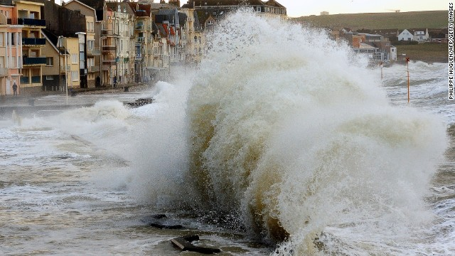 Waves batter the sea wall at Wimereux, France, on January 3.