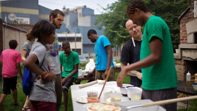 "Pittsburgh-area chef Kevin Sousa visited Braddock Farms in summer 2013 to teach teens how to make pizza. Sousa is partnering with Fetterman to launch the mayor's latest initiative: a restaurant and farm ""ecosystem"" that hopes to source some food from Braddock Farms and start a job-training program that will be a pipeline to employment in the restaurant. The project is seeking funding on Kickstarter."