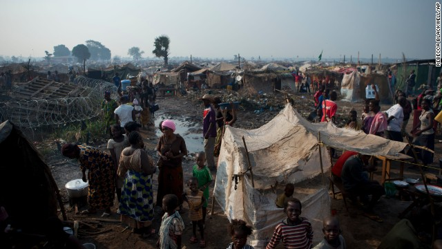 People displaced by violence attempt to create a semblance of normal life in a sprawling camp at M'poko International Airport on January 2.