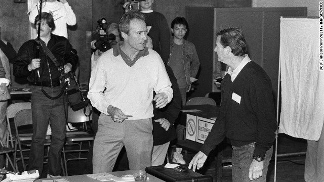 Clint Eastwood managed to make a few movies while serving as mayor of Camel-by-the-Sea, California, for one term in the 1980s. Here he's seen on voting day in 1986.