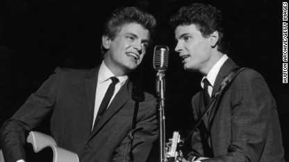 1962: Phil (left) and Don Everly, the American rock n' roll duo the Everly Brothers on stage. (Photo by Hulton Archive/Getty Images)
