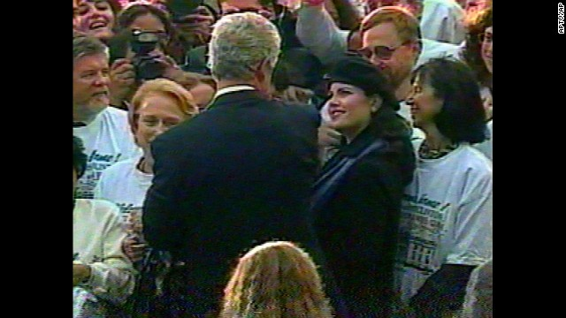 In this image taken from a video, Lewinsky watches Clinton as he greets staff at the White House during a re-election celebration in November 1996.