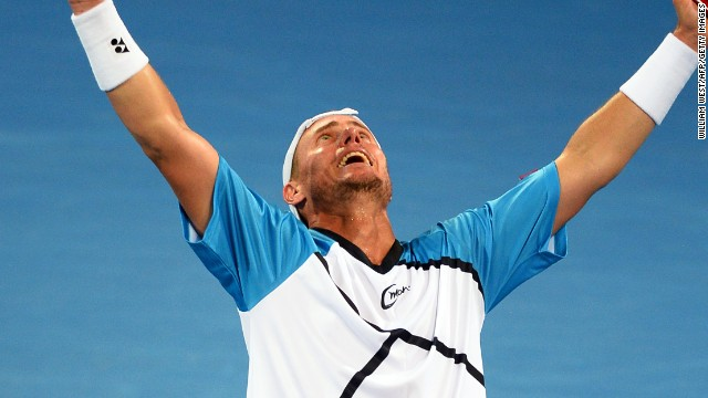 Home favorite Lleyton Hewitt celebrates after beating Roger Federer in the Brisbane final Sunday.
