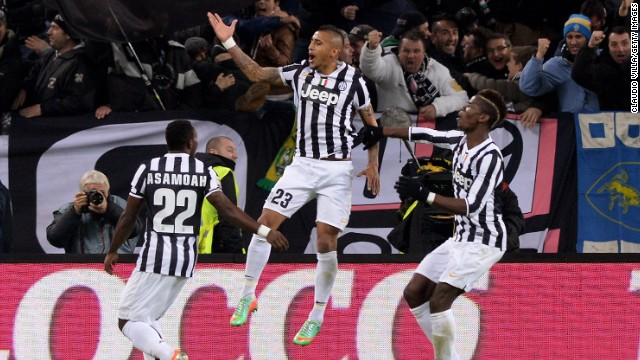 Arturo Vidal, middle, leaps in the air after scoring Juventus' first goal Sunday against Roma.
