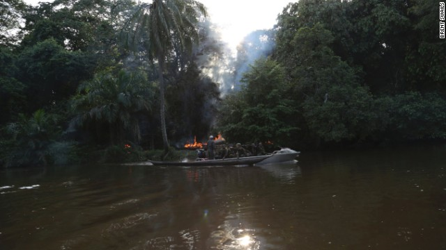 Odzala Park's Eco Unit heads back out on the river after torching an active poacher's camp. The team finds four guns, one of which Eckel says is military issue. Of all of the weapons the unit has in its stockpile -- a combination of those handed over in the amnesty program and those seized in raids -- the majority come from military stock.