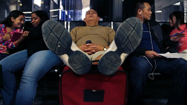 A man takes a nap at Logan International Airport after his flight was canceled Monday, January 6.