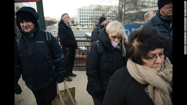 Commuters wait for a Virginia Railway Express train to arrive at Washington's L'Enfant Plaza on January 6.