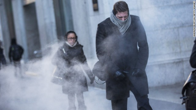 A man clenches his fists while walking past a steam vent in New York City on January 7.