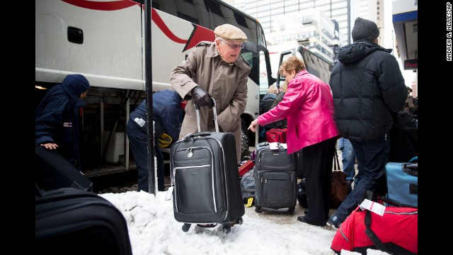 Photos: Winter weather slows travel across U.S.