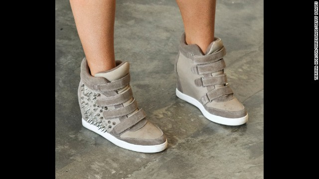 As much as city girls and fashion insiders gushed over wedge sneakers last spring and summer, the trend has run its course. In 2014, look for other fresh styles of sneakers.