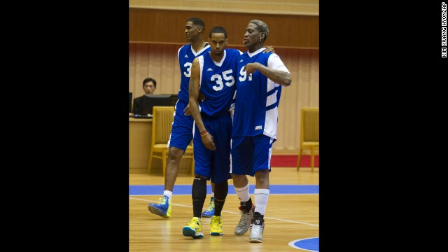 Rodman, right, walks with Dupree, center, and Charles D. Smith during the exhibition game.