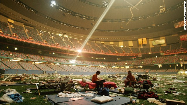 In 2005, displaced victims of Hurricane Katrina rest inside a shelter set up at the Superdome in New Orleans. Advocacy groups estimate homelessness in the city more than doubled in the aftermath of the storm. The disaster fueled dialogue on poverty and race relations in America.