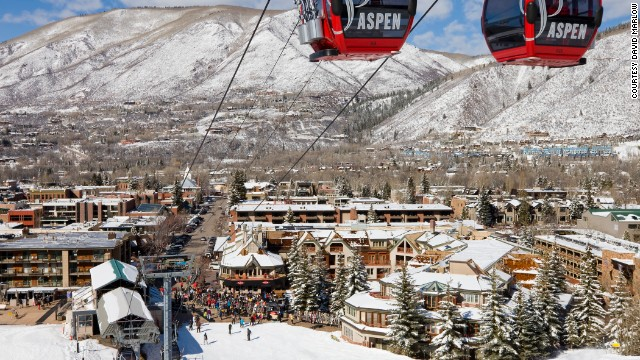 The Little Nell hotel (the complex to the right of the base of the gondola shown here) offers ski-in/ski-out access. The hotel is owned by the Aspen Skiing company, which also owns the gondola.