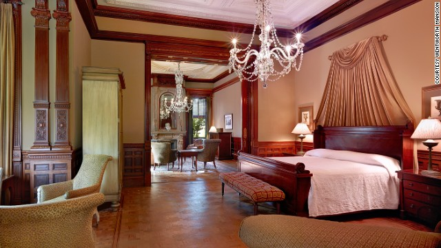 The two-room Grand Mansion Suite is lit by two original Italian chandeliers and has two marble gas fireplaces.
