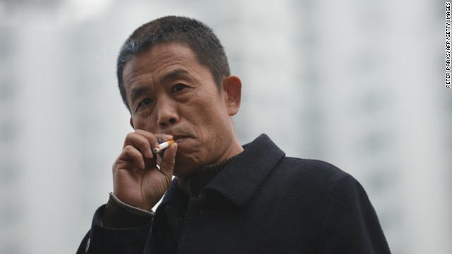 A man smokes a cigarette on a street in Shanghai on January 8.