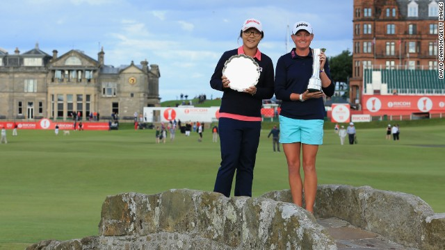 Ko and 2013 British Open champion Stacey Lewis on the famous Swilcan Bridge in St Andrews with their trophies. Ko was leading amateur and is tipped to win the professional title in future years.