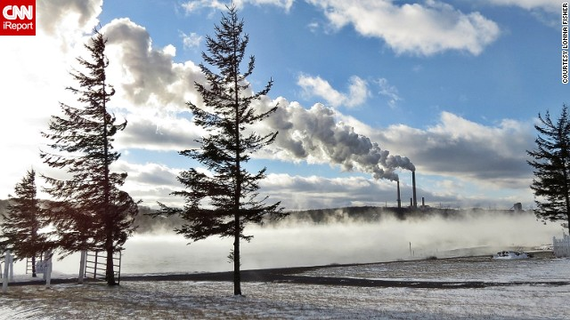 Steam from an industrial building mixes with the clouds over Mt. Storm, West Virginia. See more photos of the snowy state on <a href='http://ireport.cnn.com/docs/DOC-1063671'>CNN iReport</a>.