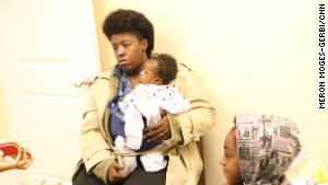 Cherelle Wright waits at CAPN with two of her children.