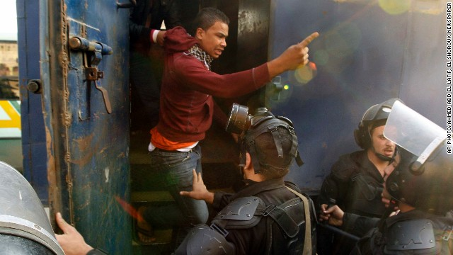 Police detain a man during clashes with supporters of ousted President Mohamed Morsi in Cairo on Friday January 10.