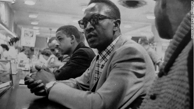 Franklin McCain and other black students wait for service at a lunch counter in a Woolworth store in Greensboro, North Carolina, in April 1960.