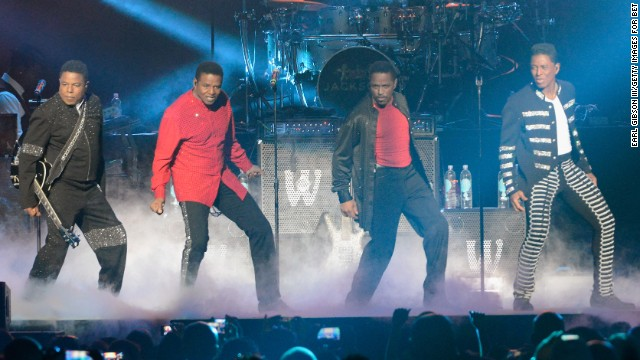 From left, Tito, Jackie, Marlon and Jermaine Jackson perform at the Staples Center last June in Los Angeles.