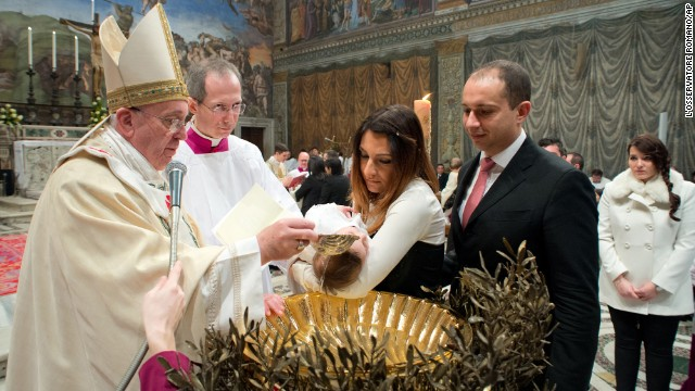 Pope Francis baptizes 32 children