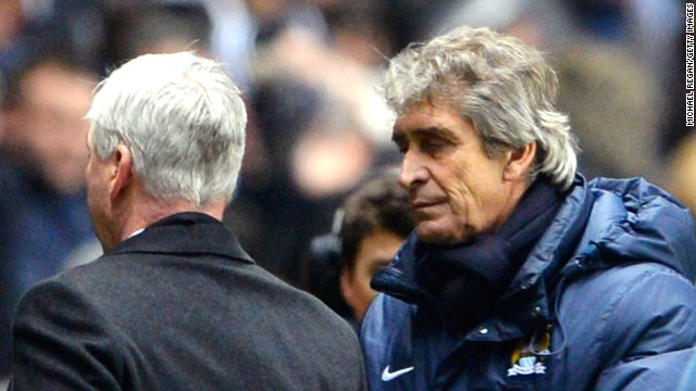 Manuel Pellegrini (R) with Alan Pardew following Manchester City's controversial win over Newcastle.