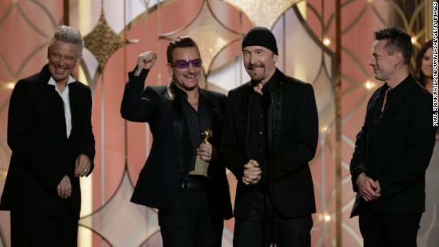 "Adam Clayton, Bono, The Edge and Larry Mullen Jr. of U2 accept the award for best original song. The song ""Ordinary Love"" was produced by Danger Mouse and is from the film ""Mandela: Long Walk to Freedom."""