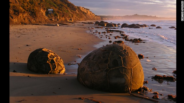 Large spherical boulders that formed millions of years ago on the ancient sea floor now dot Koekohe Beach on the east coast of New Zealand's South Island. They're what geologists call septarian concretions.