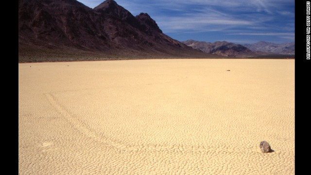 "Ordinary stones seem to ""sail"" over the dry earth, leaving a trail behind, in Death Valley National Park. The prevailing theory for this strange phenomenon involves ice that forms around the stones, causing them to move and to leave a trail in their wake."