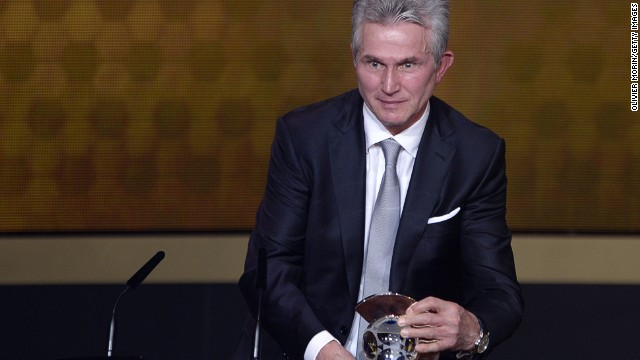 Now-retired Jupp Heynckes receives the Coach of the Year award after leading Bayern Munich to a Champions League, Bundesliga and German Cup treble in 2013.