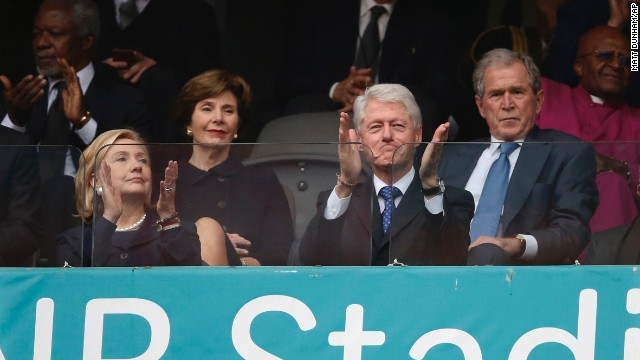 From left, Clinton, former first lady Laura Bush and former Presidents Bill Clinton and George W. Bush listen to speakers during the memorial service for Nelson Mandela in Soweto, South Africa, on December 10, 2013.