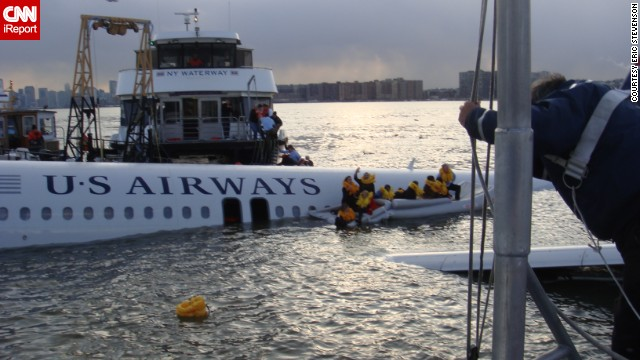 <a href='http://ireport.cnn.com/docs/DOC-183399'>Eric Stevenson</a> was a passenger on flight 1549, seated over the wing in 12F. He took this photo just after boarding the rescue boat.