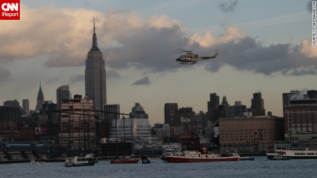 "Jim Davidson of Hoboken, New Jersey, said the scene looked ""pretty well organized"" from what <a href='http://ireport.cnn.com/docs/DOC-182001'>he could see</a> across the river. He said ferry and tourist boats pulled up to the downed plane."