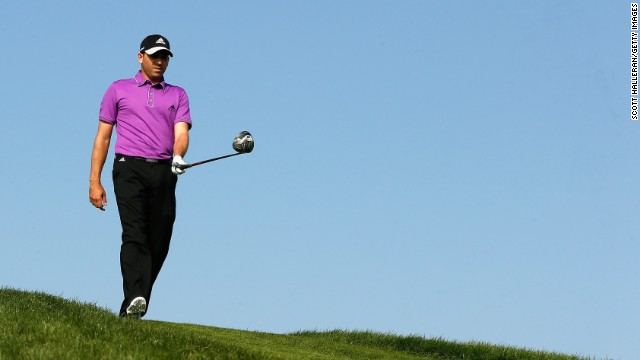 Spain's world No.10 Sergio Garcia walks the undulating desert course under brilliant blue skies