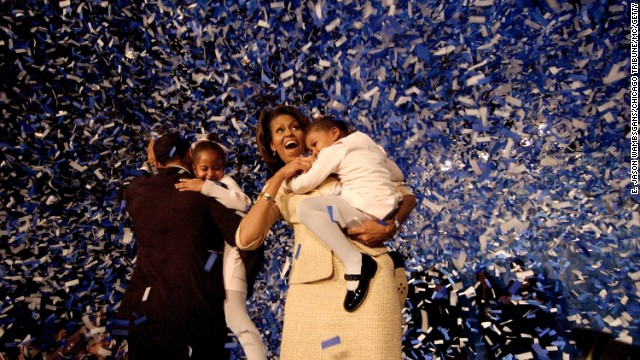 The Obamas celebrate during a victory party in Chicago on November 2, 2004.