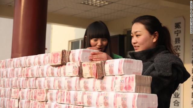 Building the 'money wall' in Jianshe village