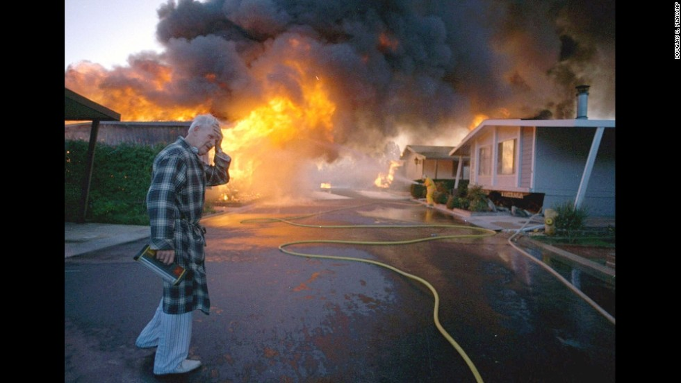Ray Hudson reacts as a friend's home goes up in flames after a 6.7-magnitude earthquake hit the San Fernando Valley area of Los Angeles on January 17, 1994. The <a href='http://earthquake.usgs.gov/earthquakes/states/events/1994_01_17.php' target='_blank'>Northridge earthquake</a> killed 60 people, injured more than 7,000 and damaged more than 40,000 buildings, according to the United States Geological Survey.