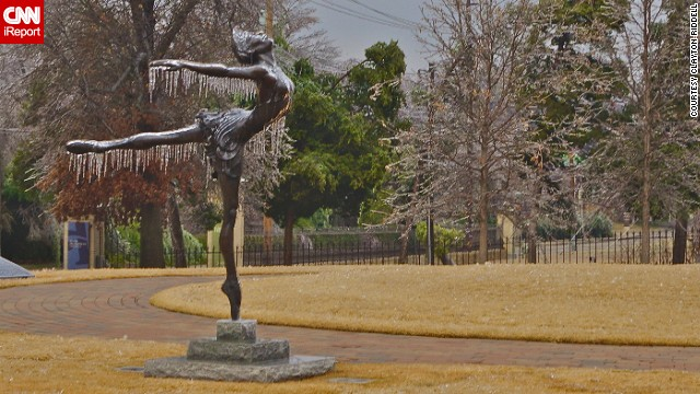 "Icicles cover a sculpture of a dancer in Tulsa's Municipal Rose Garden. ""I thought the beauty of the sculptures was only enhanced by the ice,"" said Clayton Riddell. See more of his photos on CNN iReport."