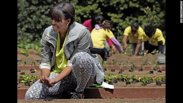 "Michelle Obama plants the White House Kitchen Garden on the South Lawn of the White House in April. To help her, she invited students from schools ""that have made exceptional improvements to school lunches."" It was part of the first lady's ""Let's Move"" campaign, which she launched in 2010 to reduce childhood obesity."