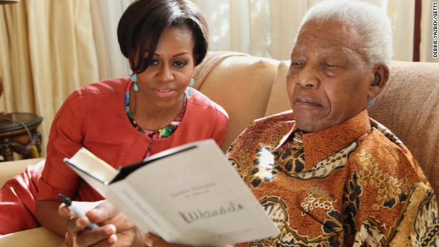 The first lady meets with former South African President Nelson Mandela in June 2011.