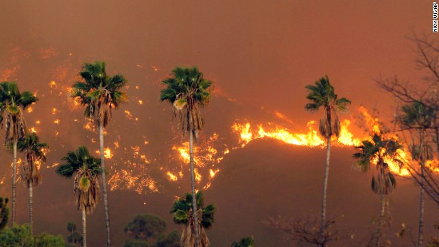 The wildfire burns in the hills just north of Glendora on January 16.