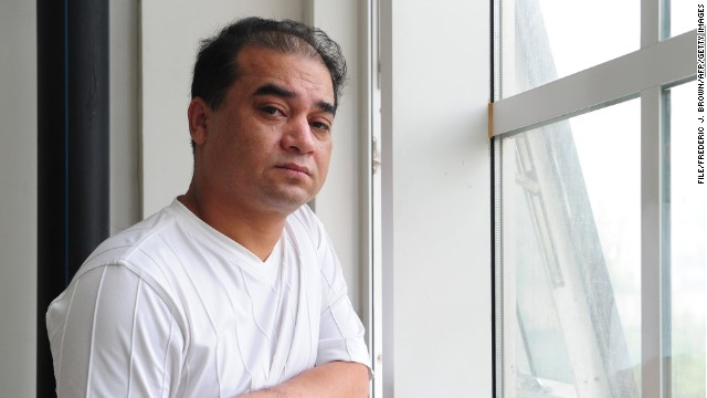Ilham Tohti pauses by a classroom window before a lecture in Beijing on June 12, 2010.