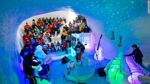 Up to 170 audience members chill with the band in an igloo auditorium. The organizers' clothing advice? Layer.