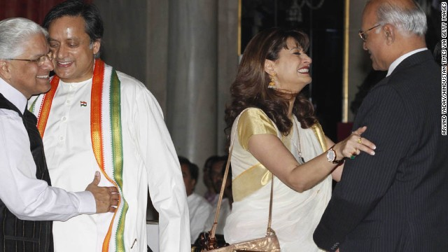 Tharoor and his wife, with Ashwani Kumar, left, and Shiv Shankar Menon, attend a swearing-in ceremony for new ministers at Rashtrapati Bhavan, the Indian President's home, on October 28, 2012, in New Delhi. The couple was active in New Delhi's glamorous social circles.<!-- --> </br>