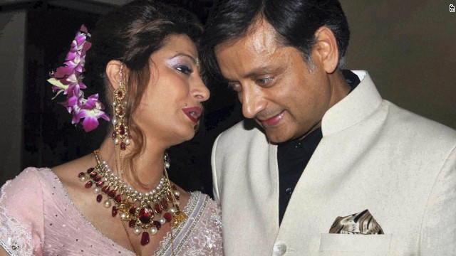 Tharoor listens to his wife at their wedding reception in New Delhi on September 4, 2010.