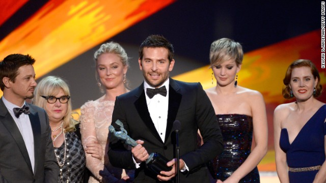 "Bradley Cooper and the cast of ""American Hustle"" accept the award for outstanding performance by a cast in a motion picture. Cooper, practically yelling his approval, paid tribute to director David O. Russell for the film."