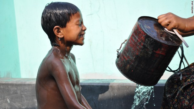 A young boy takes a bath at a public water stand post near Uttar Bishli, Bangladesh.